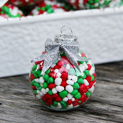 Candy Filled Ornaments - Try these 35+ DIY ideas for clear glass ornaments to add precious memories and lots of spirit to your Christmas tree! from @tipsaholic #ornaments #diy #christmas